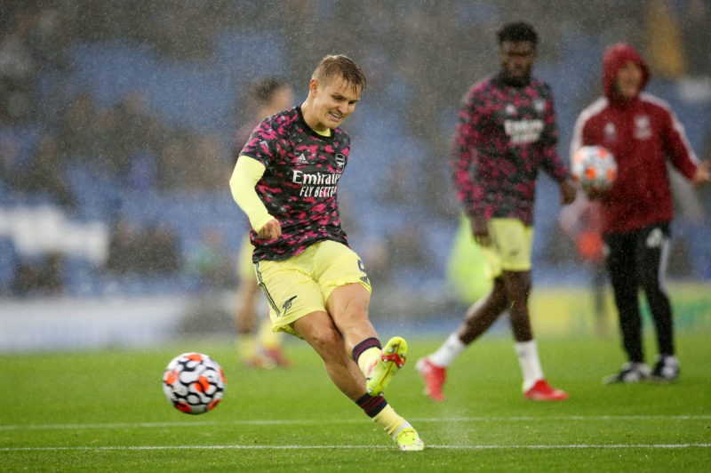 BRIGHTON, ENGLAND - OCTOBER 02: Martin Odegaard of Arsenal shoots during the warm up prior to the Premier League match between Brighton & Hove Albion and Arsenal at American Express Community Stadium on October 02, 2021 in Brighton, England. (Photo by Steve Bardens/Getty Images)