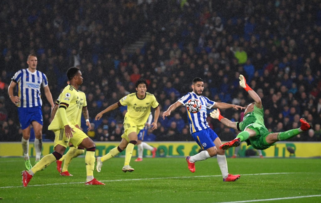 BRIGHTON, ENGLAND - OCTOBER 02: Aaron Ramsdale of Arsenal makes a save from Neal Maupay of Brighton & Hove Albion during the Premier League match between Brighton & Hove Albion and Arsenal at American Express Community Stadium on October 02, 2021 in Brighton, England. (Photo by Mike Hewitt/Getty Images)