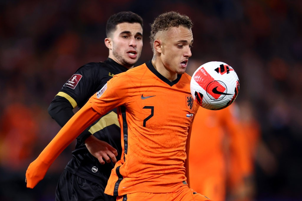 ROTTERDAM, NETHERLANDS: Noa Lang of Netherlands in action against, Julian Valarino of Gibraltar during the 2022 FIFA World Cup Qualifier match between Netherlands and Gibraltar at De Kuip on October 11, 2021. (Photo by Dean Mouhtaropoulos/Getty Images)